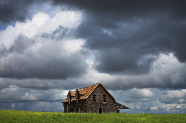 House beneath a stormy sky